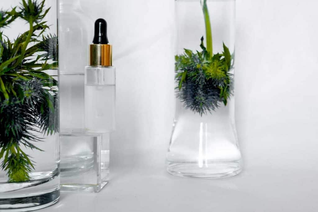 Natural hyaluronic serum on trendy abstrac background. Natural materials and skin care concept. Horizontal view copyspace