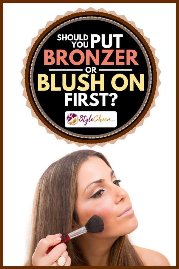 Young beautiful woman applying makeup on her face, Should You Put Bronzer Or Blush On First?