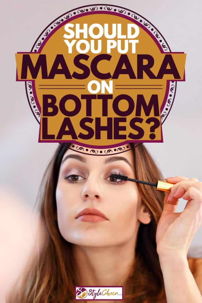 A young beautiful woman putting on mascara on her eyelids, Should You Put Mascara On Bottom Lashes?