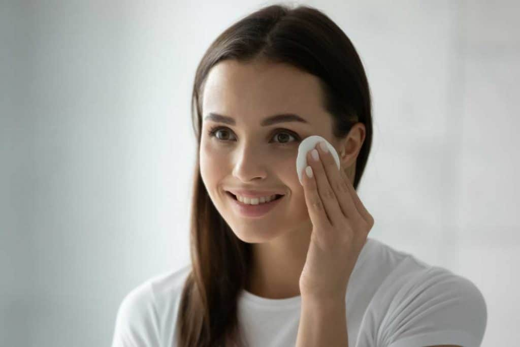 Smiling millennial girl applying toner on her face, Can You Use Glycolic Acid Toner Everyday?