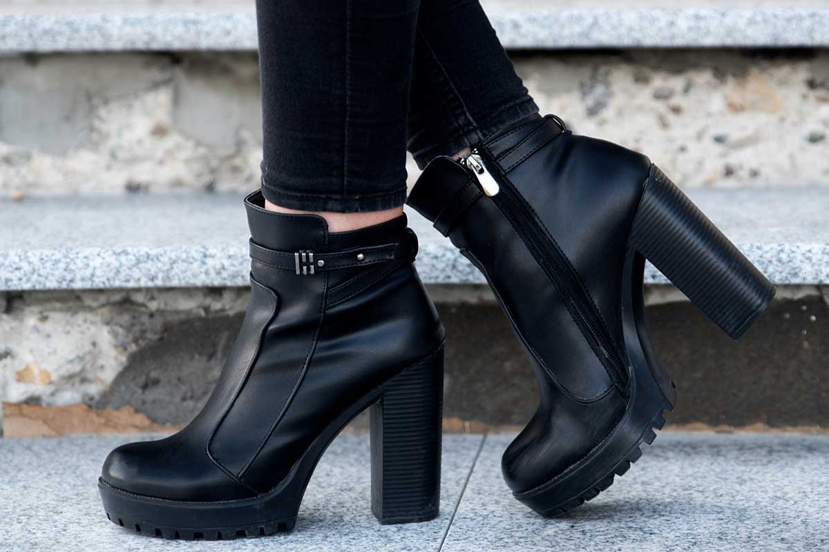 Woman wearing black boots outdoor, 25 Types of Boots for Women [A Fashion Guide]