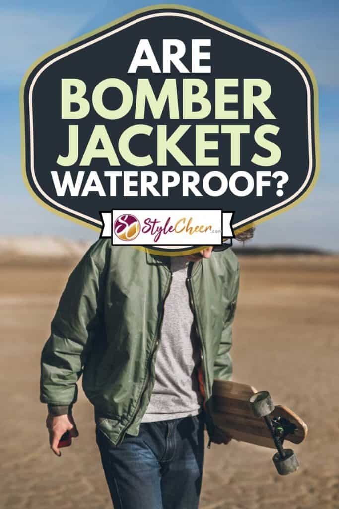 Young rebelious skater with his board, walking alone wearing bomber jacket, Are Bomber Jackets Waterproof?