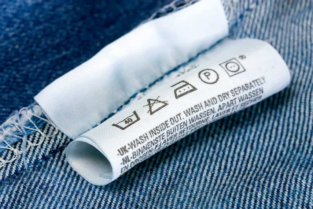 Care instructions label on the inside of a denim garment