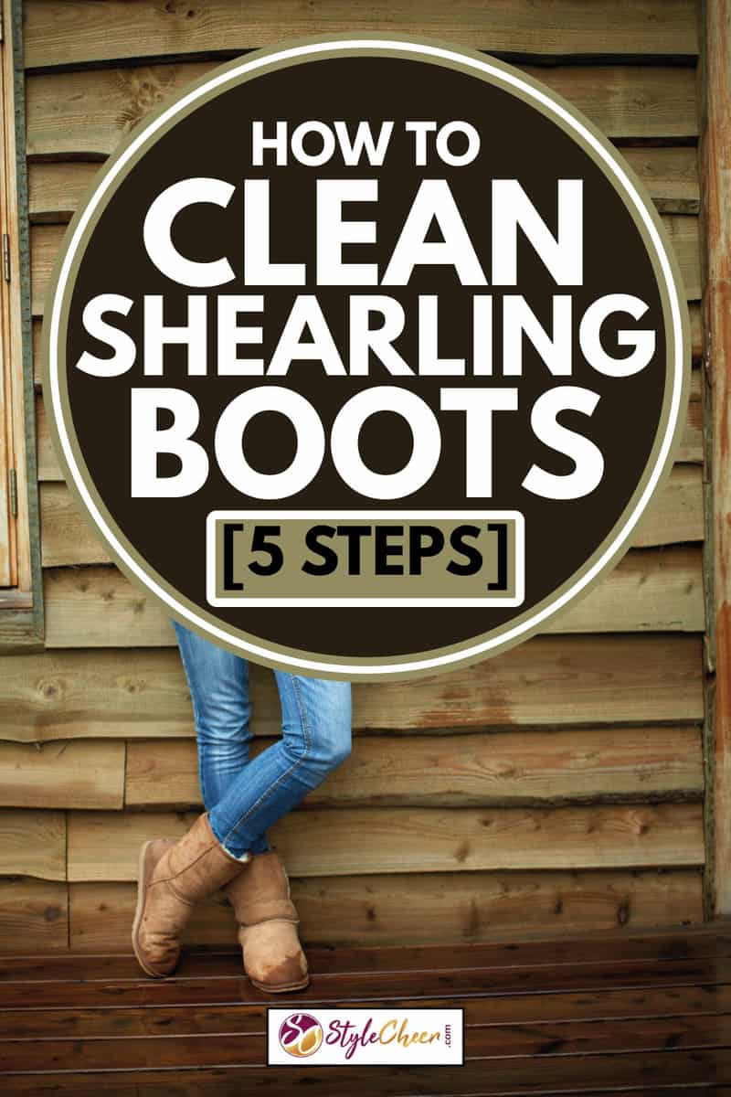 Full length portrait of confident woman standing arms crossed against wooden wall while wearing shearling boots, How To Clean Shearling Boots [5 Steps]
