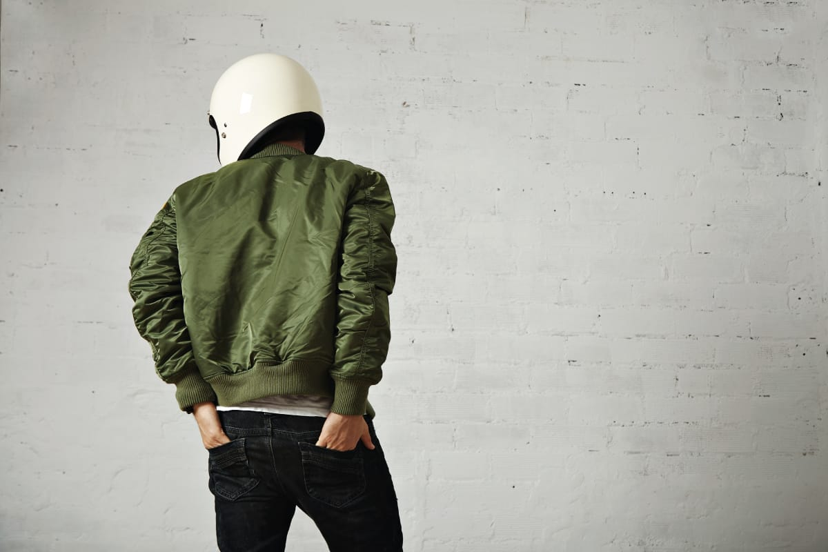 Green bomber jacket worn by a moto biker, How Long Should A Bomber Jacket Be?