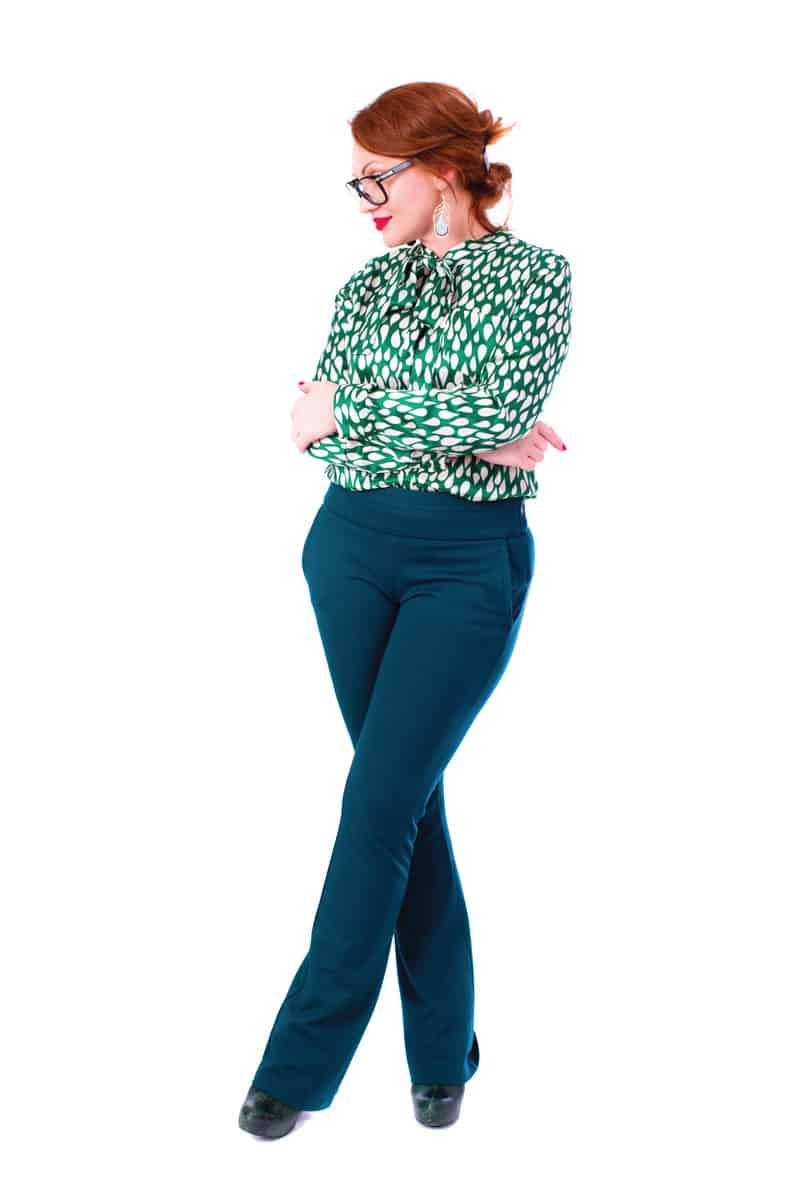 Stylish middle-aged lady standing with legs crossed