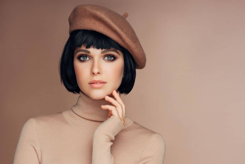 Woman with a French Bob hairstyle with a beret on her head, Does A French Bob Hairstyle Have Layers?