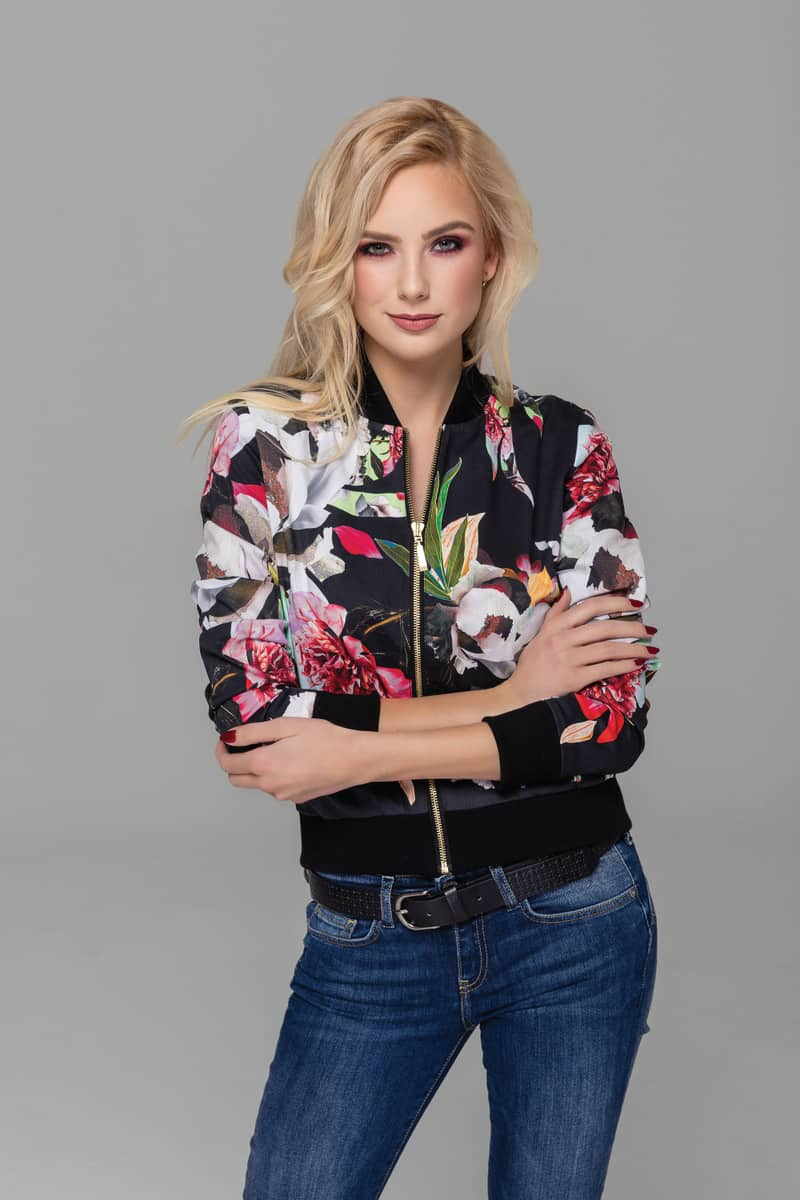 Beautiful blond model wearing floral bomber jacket