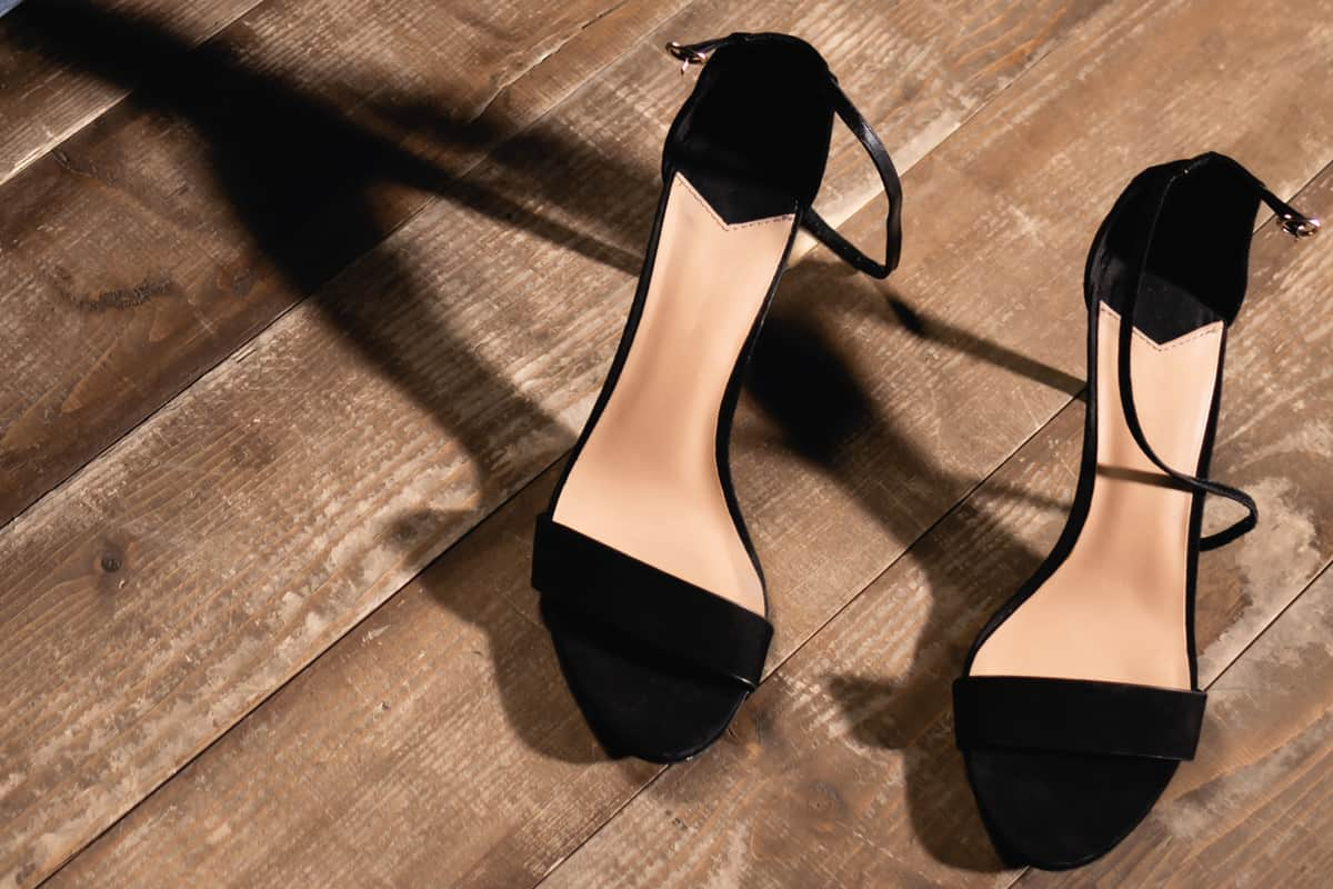 Black high heeled shoes on wooden floor, non-slip shoes