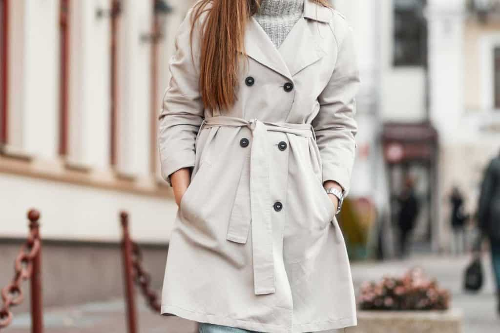 Charming young woman with brown hair in elegant stylish trench coat, Should a Coat Be Fitted or Loose?