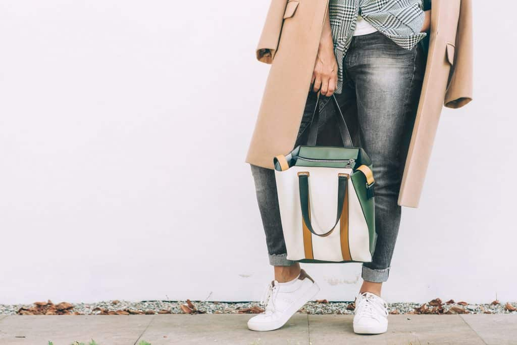 Close up image woman autumn city casual outfit with shopper bag