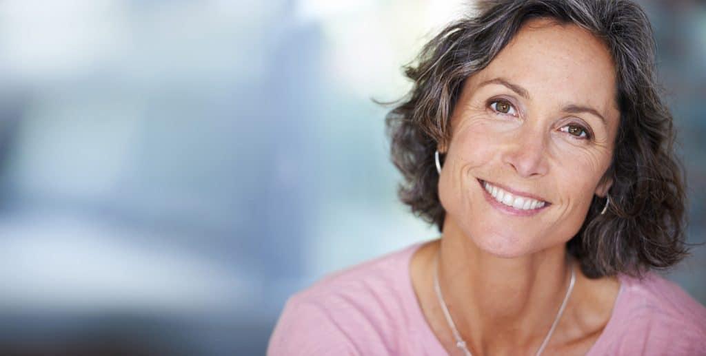 Closeup shot of a mature woman with makeup sitting