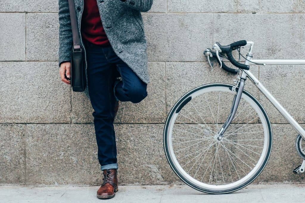 Elegant man with a bicycle using a smart phone in the city, How To Make Straight Leg Pants Skinny (Even Without Sewing)