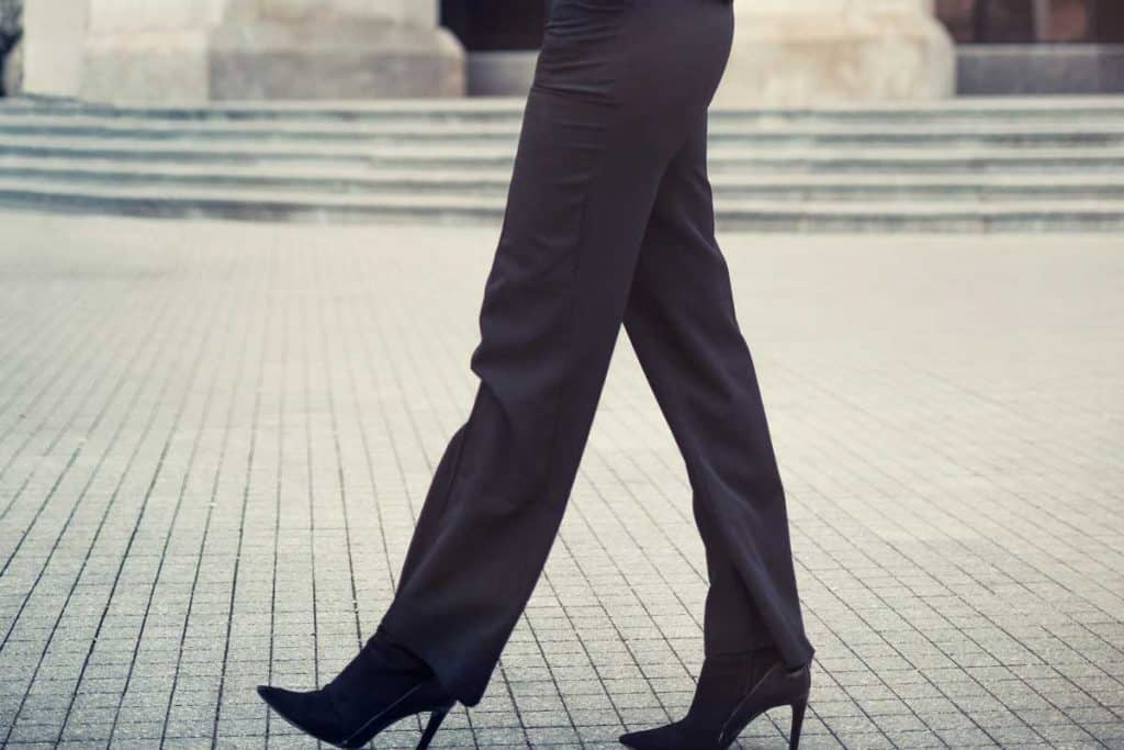 Fashionable business woman wearing straight leg pants walking on the city street, How Long Should Straight-Leg Pants Be?