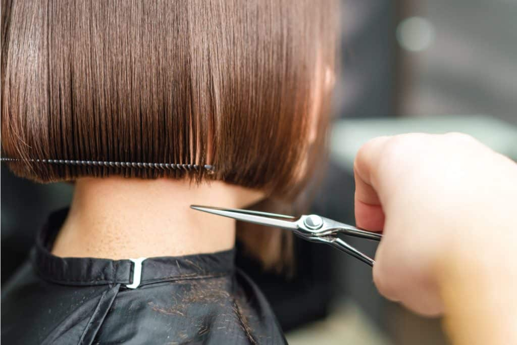 Hairdresser cutting brown short hair with scissors, What Face Shape Suits A Bob Haircut?