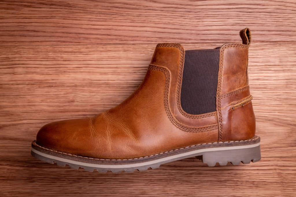 Leather Chelsea boot detail on wood, How To Fix The Elastic On Chelsea Boots