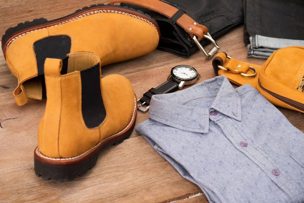 Men fashion casual clothing set and accessories on wooden background