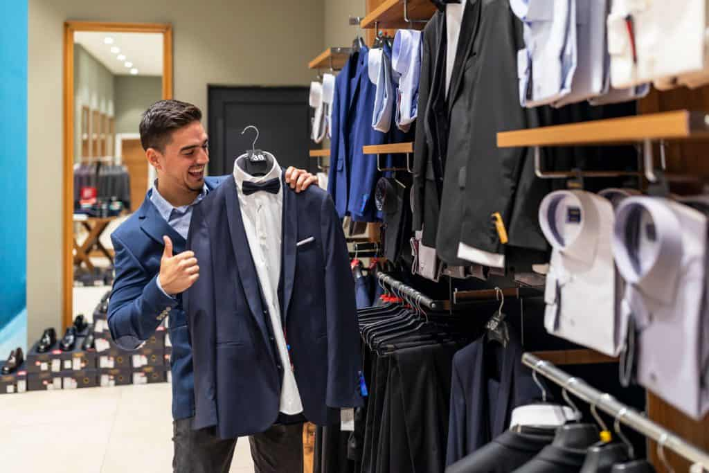 A portrait of a man shopping at a clothing store, 31 Types of Coats And Jackets You Should Know