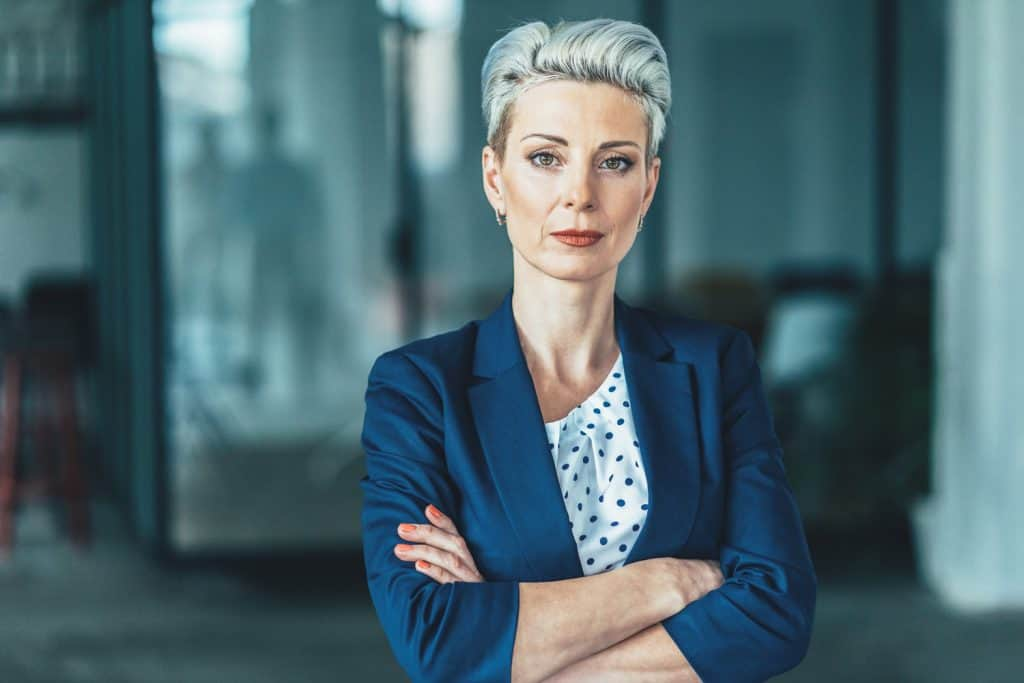 Portrait-of-confident,-successful-business-woman-with-makeup-at-office
