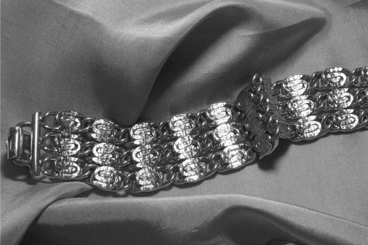 Vintage rhodium bracelet on gray silk, metal is etched with very fine cross hatching