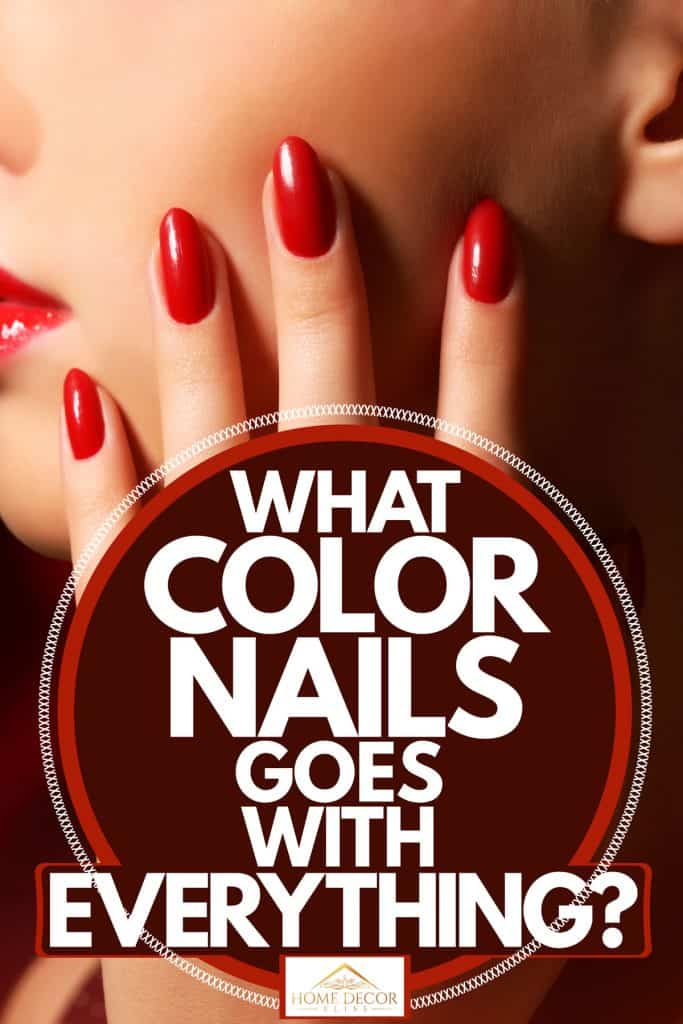 A woman showing her red nails, What Color Nails Goes With Everything?