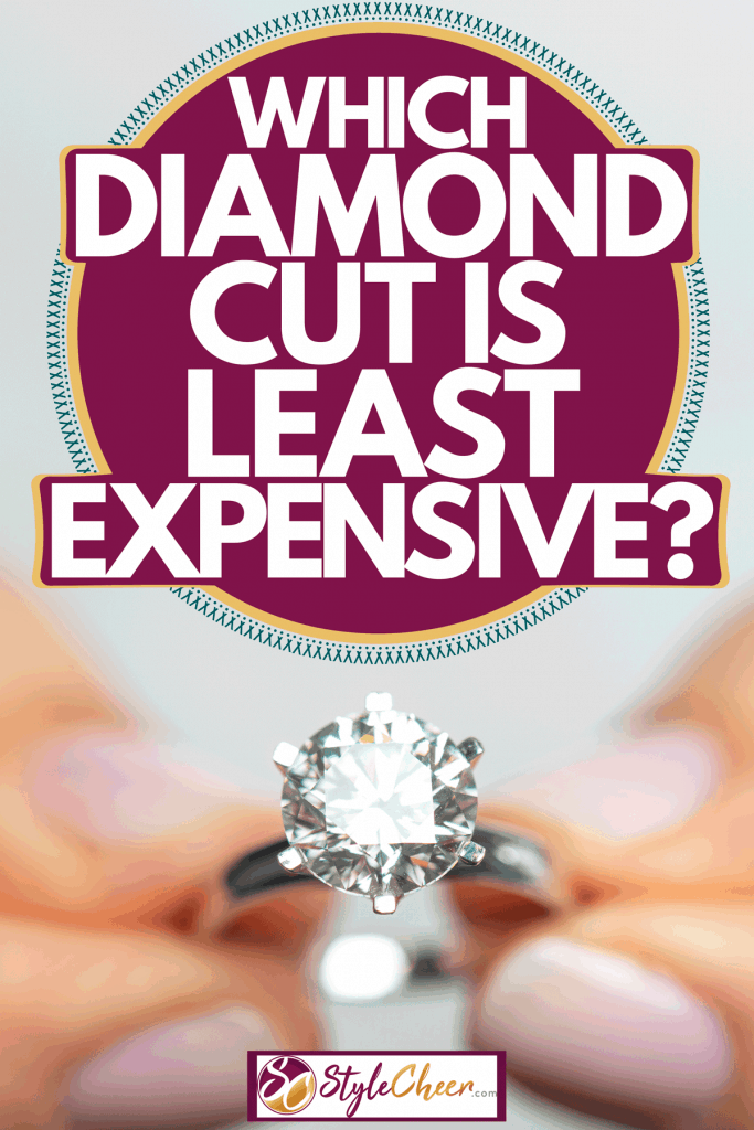 A woman holding an expensive diamond ring, Which Diamond Cut Is Least Expensive?
