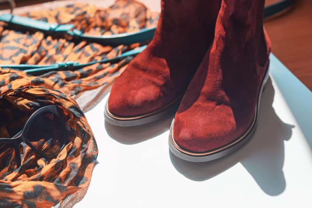 Leopard print light scarf and Chelsea boots on the floor, How To Clean Chelsea Boots [6 Effective Ways!]