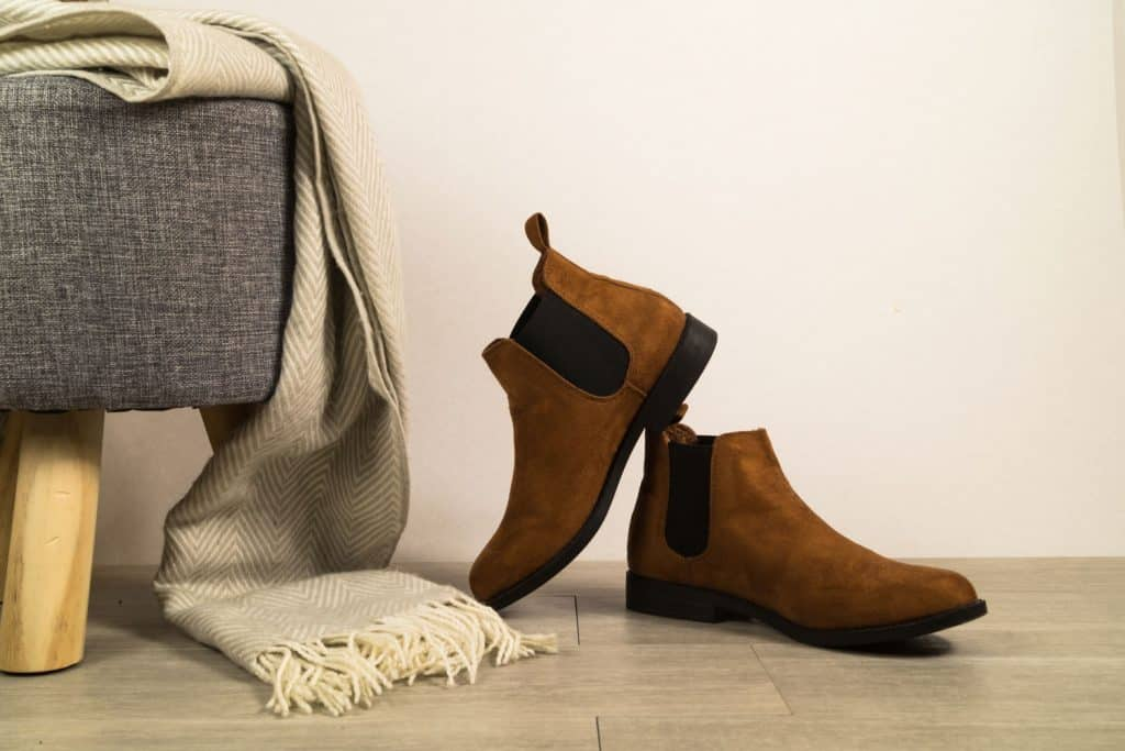 Women autumn shoes or chelsea boots on floor