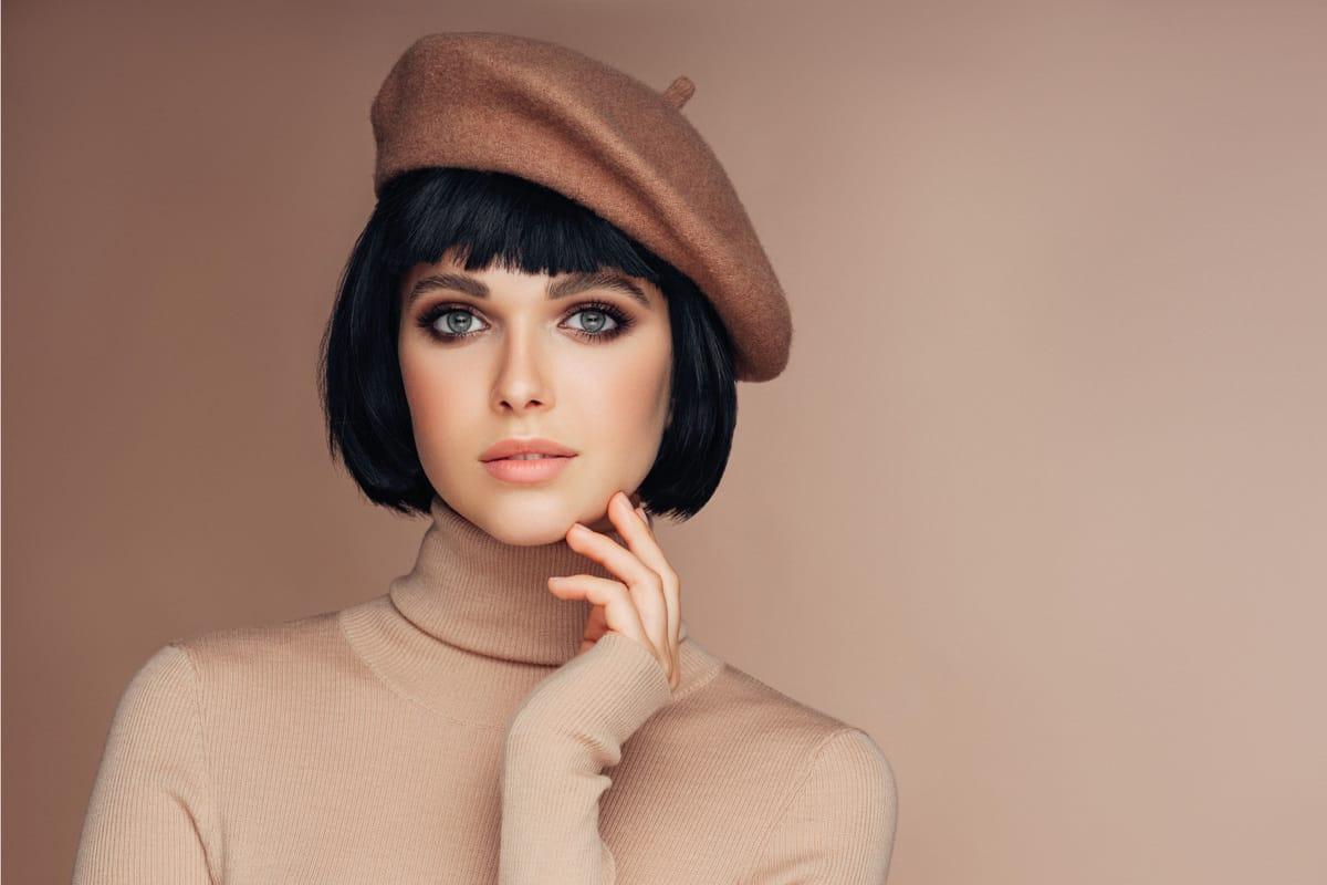 beautiful young woman wearing a beret on a french bob haircut