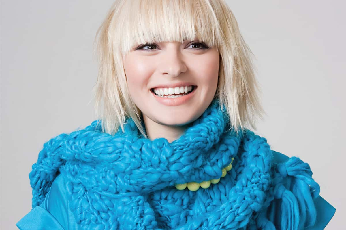blonde woman with shagged bob smiling for the camera