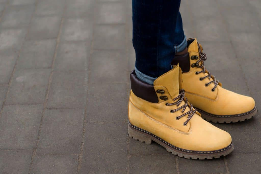 girl in beautiful yellow winter shoes on the street