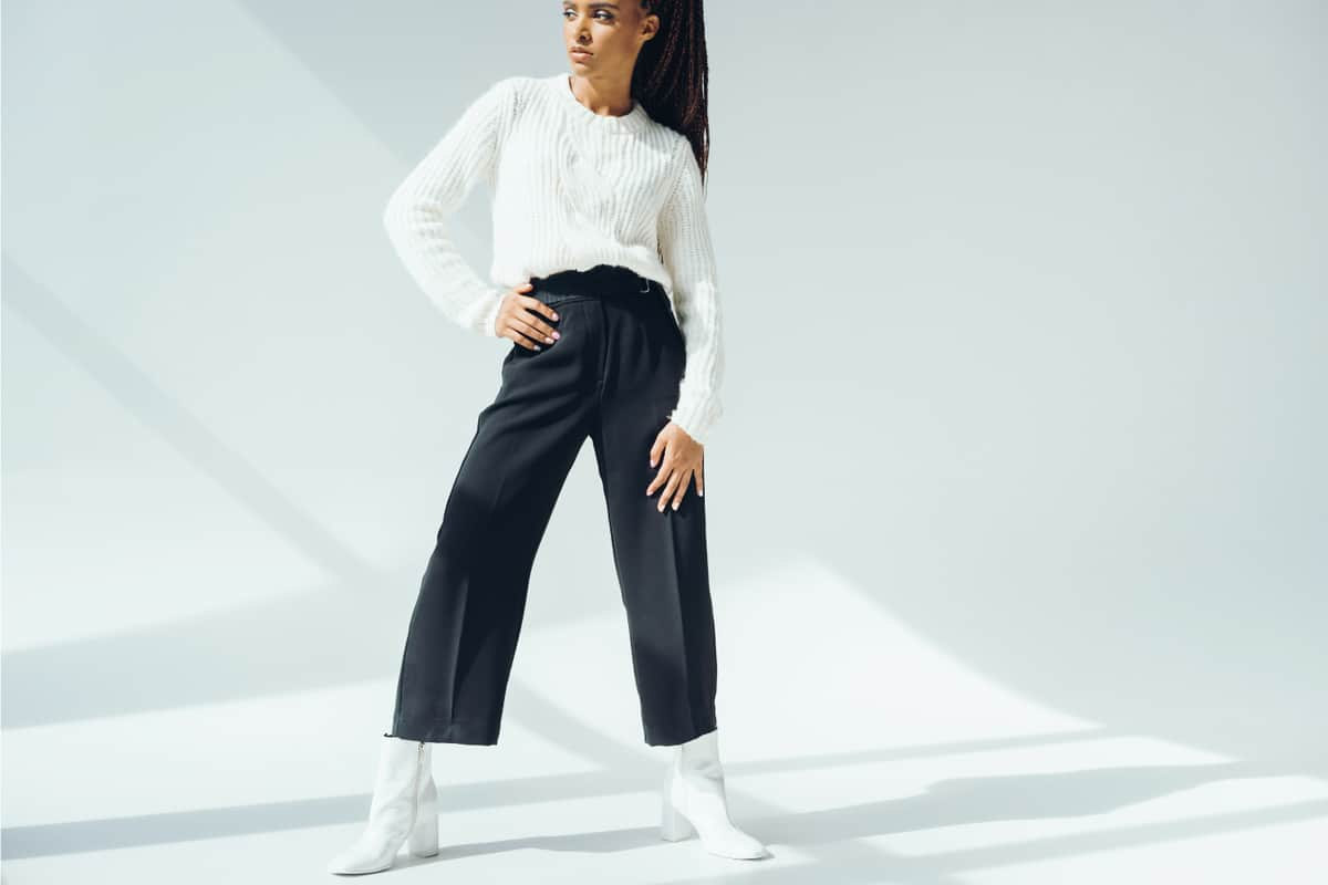 Girl model wearing get yourself a pair of white patent ankle boots for your black capris