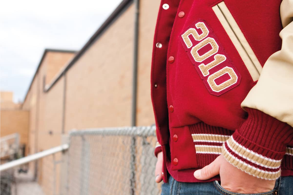 Red varsity jacket worn by a college student