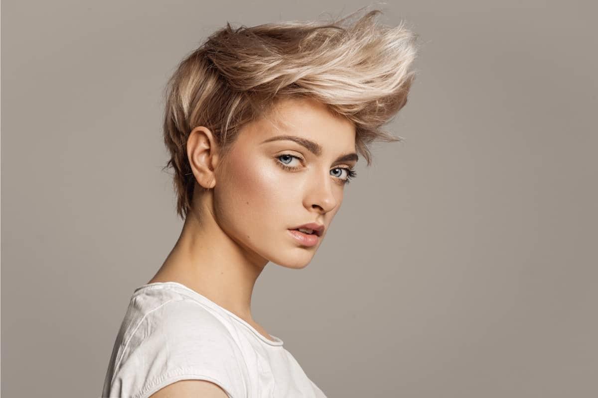 woman in faux hawk haircut facing side ways