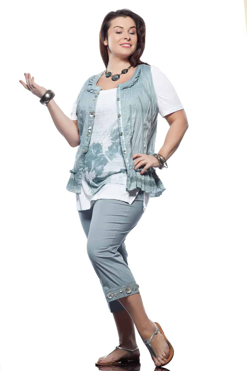 Dress up cute capris with layered blouses and bold jewelry