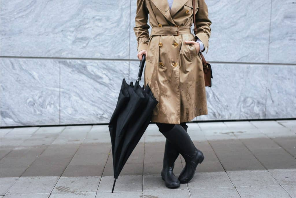 Woman wearing trench coat, rain boots and umbrella, What To Wear With Rain Boots?