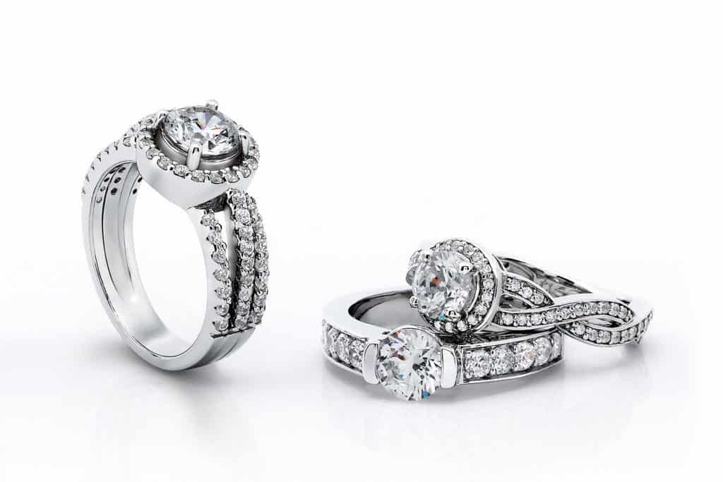 A beautiful diamond engagement rings in white gold lay on a isolated white background
