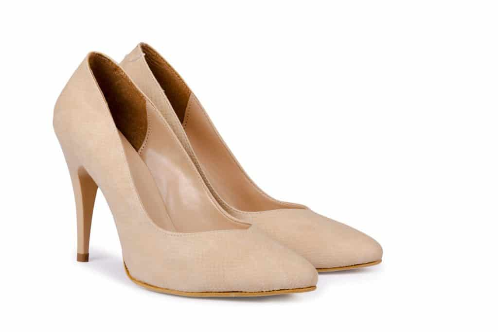 A beige colored high heeled shoes