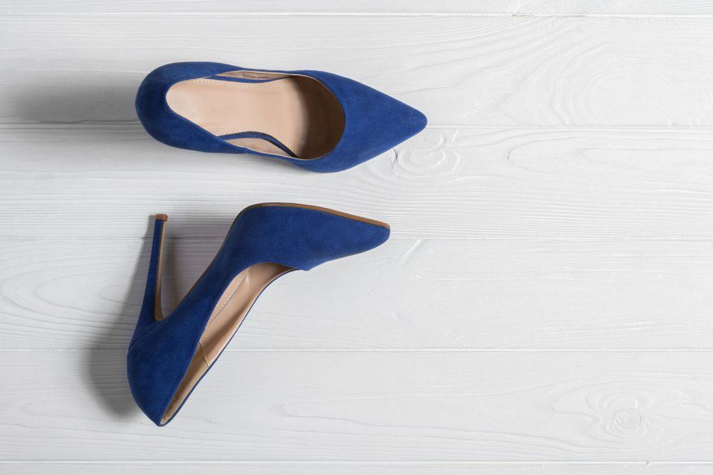 A blue pair of high heeled shoes