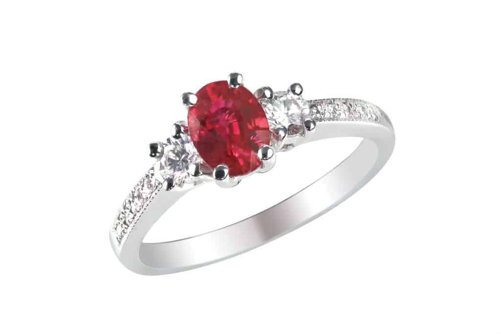 A gorgeous ruby ring encrusted with diamonds on the side