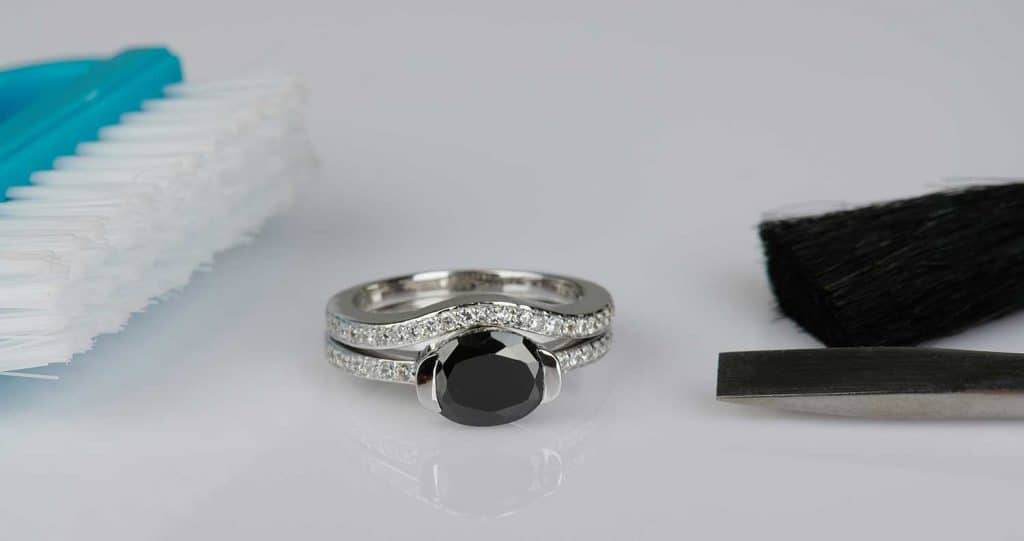 A jewelry ring with cleaning materials on the table