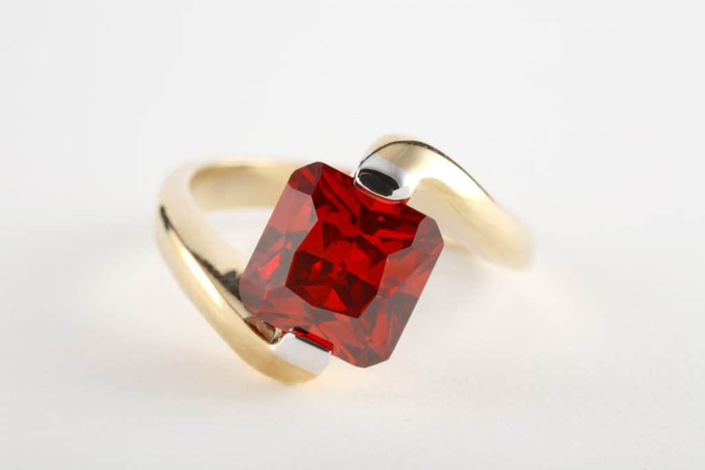 A square ruby with a gold plated ring