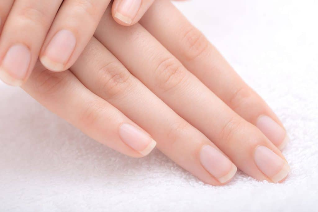 A woman showing her gorgeous fingers and nails