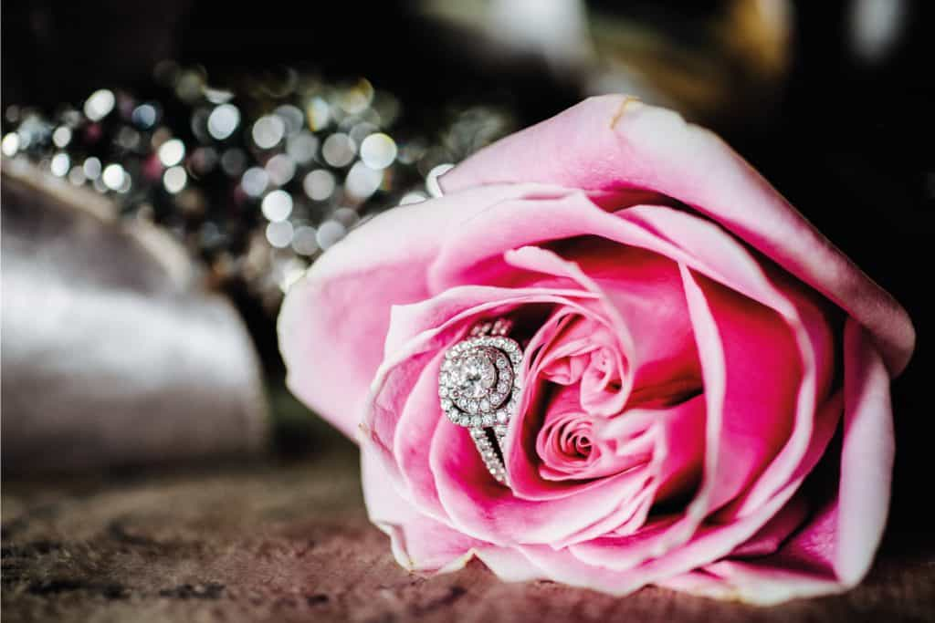 A women's wedding ring anniversary band in a pink rose, What Finger Does Anniversary Band Go On?