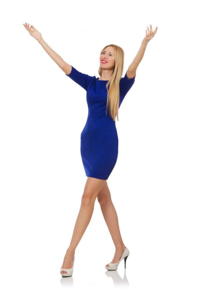 Beautiful lady in dark blue dress isolated on white wearing white shoes