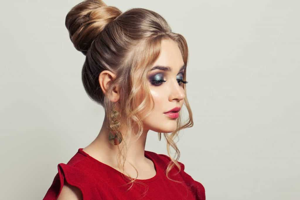 Beautiful model woman with trendy fashionable makeup wearing red dress, What Color Eyeshadow With a Red Dress? [5 Suggestions with Pictures]