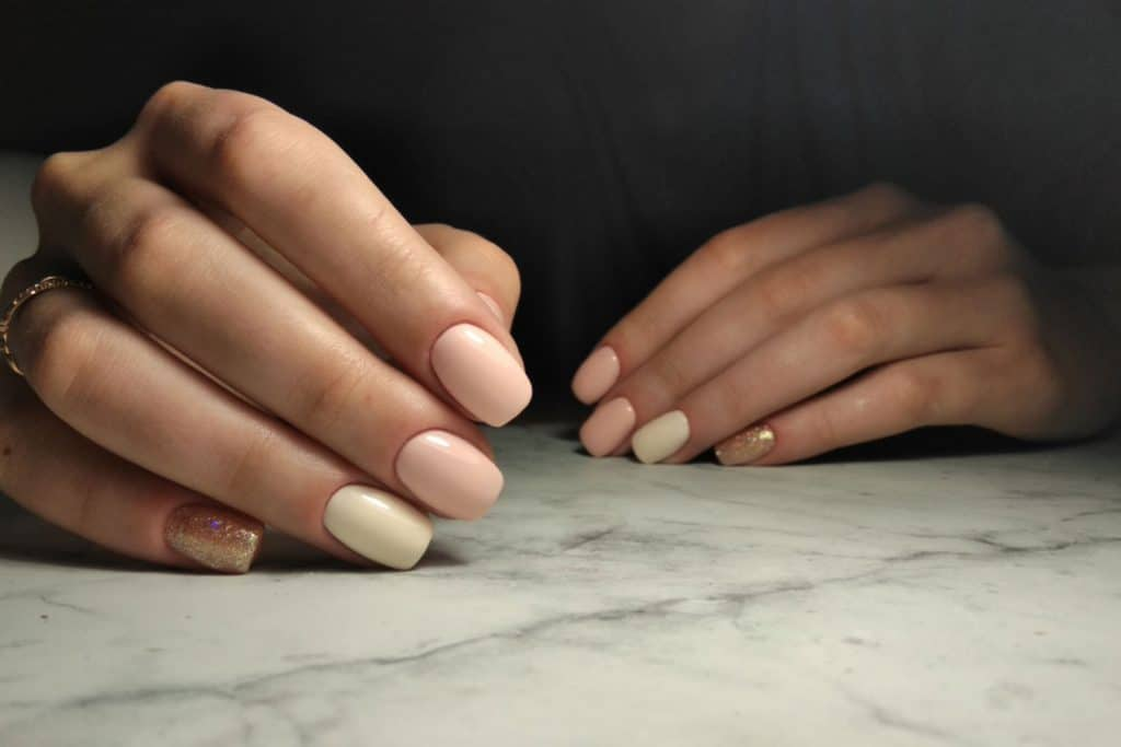 Delicate manicure with gray and beige nail shellac coating, How Long Do Shellac Nails Last?