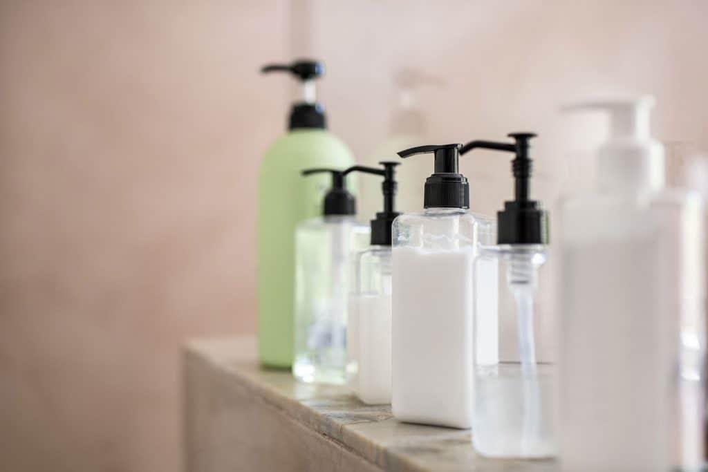 Dispenser bottles in a row on a bathroom countertop