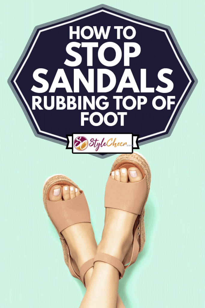 Female feet with white pedicure and brown sandals on mint green background, How to Stop Sandals Rubbing Top of Foot