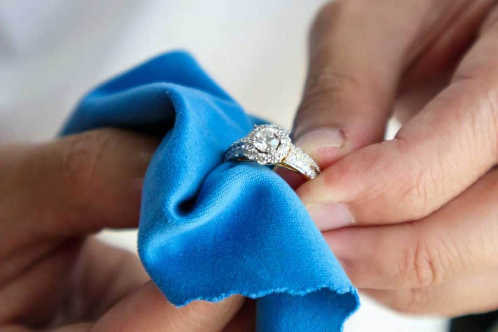 Jeweller hand polishing and cleaning jewelry diamond ring with micro fiber fabric, 4 Best Engagement Ring Cleaners